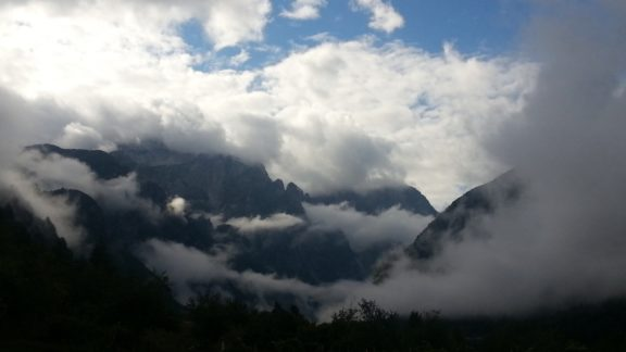 Accursed Mountains Emerging From Clouds