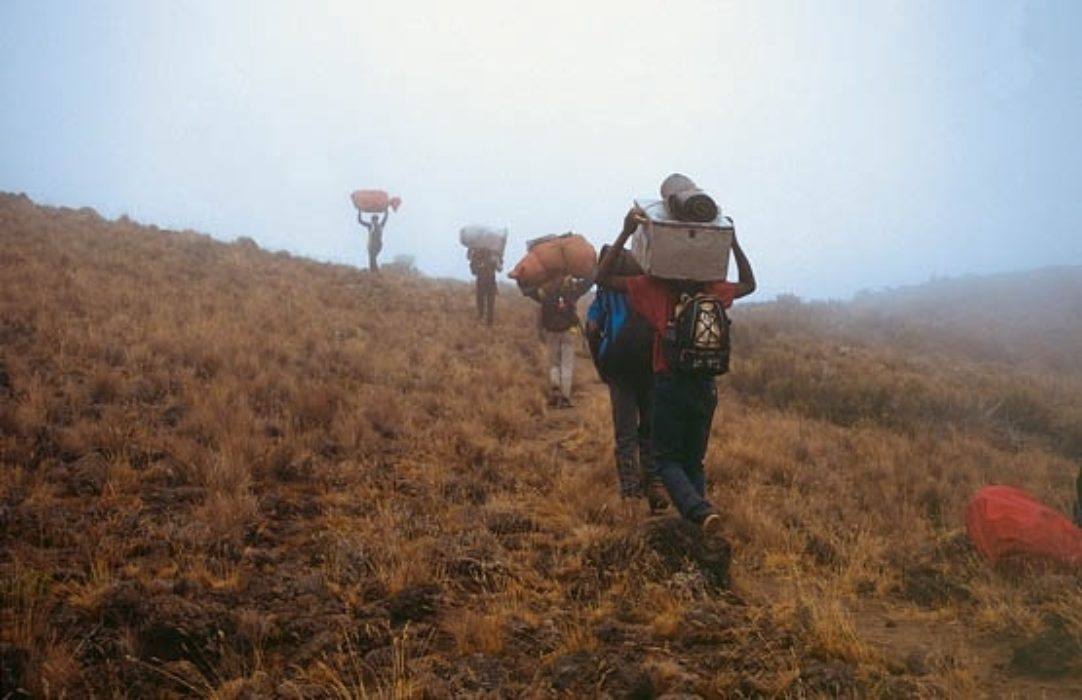 042 Porters Ascending To The Saddle Through Cloud