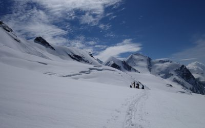 This group were doing it right: Skiing! We, on the other hand, were labouring through deep snow