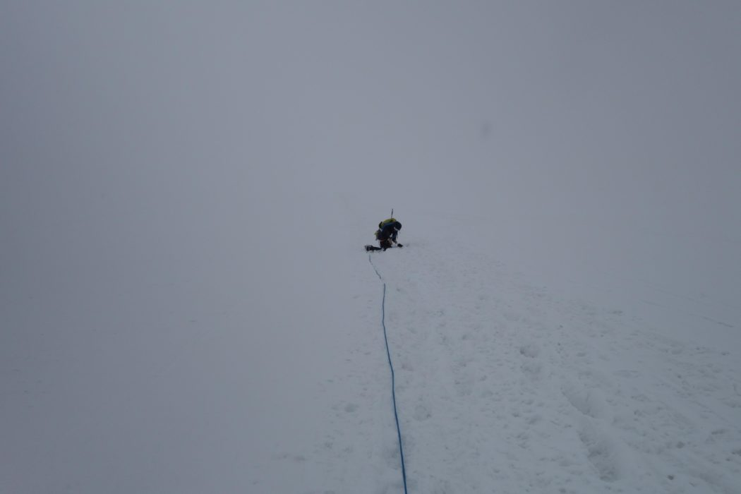 Caroline finally succumbed to needing to retie her shoelaces. The snow was now coming in and we were hurrying to make it to the last cablecar down from the Breithorn