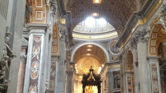 The interior of St. Peter's Basilica is one piece of the splendor of Vatican City. (Way of St Francis/Via di Francesco and Via Francigena)