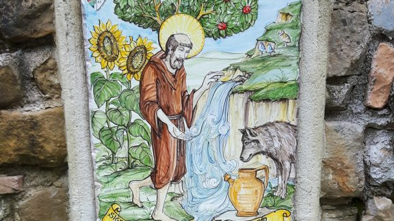 Fountain with painting of St Francis and the wolf (during his stay in the town of Gubbio Francis was said to have tamed a wolf that was raiding towns and farmsteads).