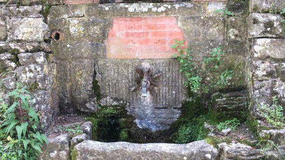 Water fountain and shrine near the village of Ferrano