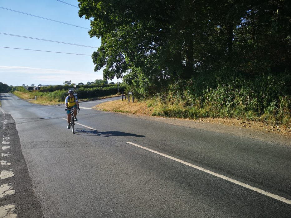 I stopped a random person to take this photo of me cycling on the wrong side of the road. Excellent.