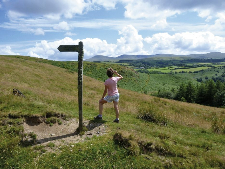 A Fingerpost Points The Way To The Physicians Well