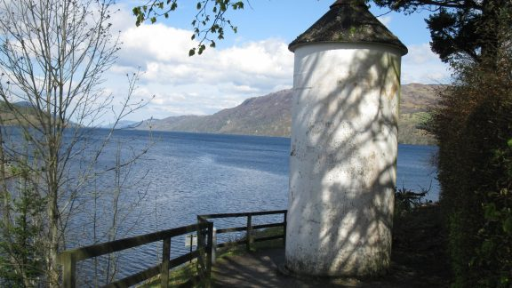 A pepper pot lighthouse on the shore of Loch Ness
