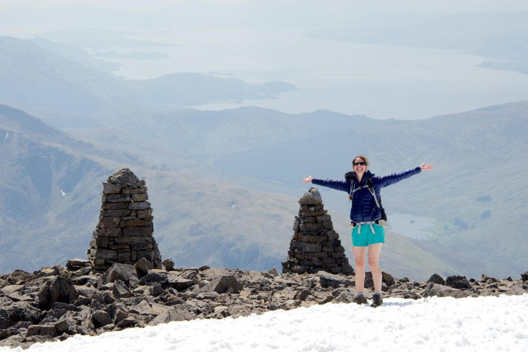 Alice is happy to find the navigation cairns on the summit plateau of Ben Nevis