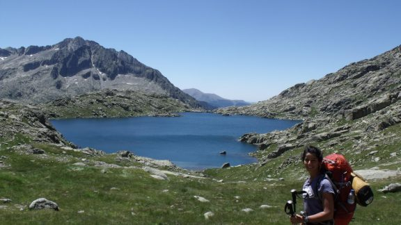 GR11 hiker above Estany de Monges