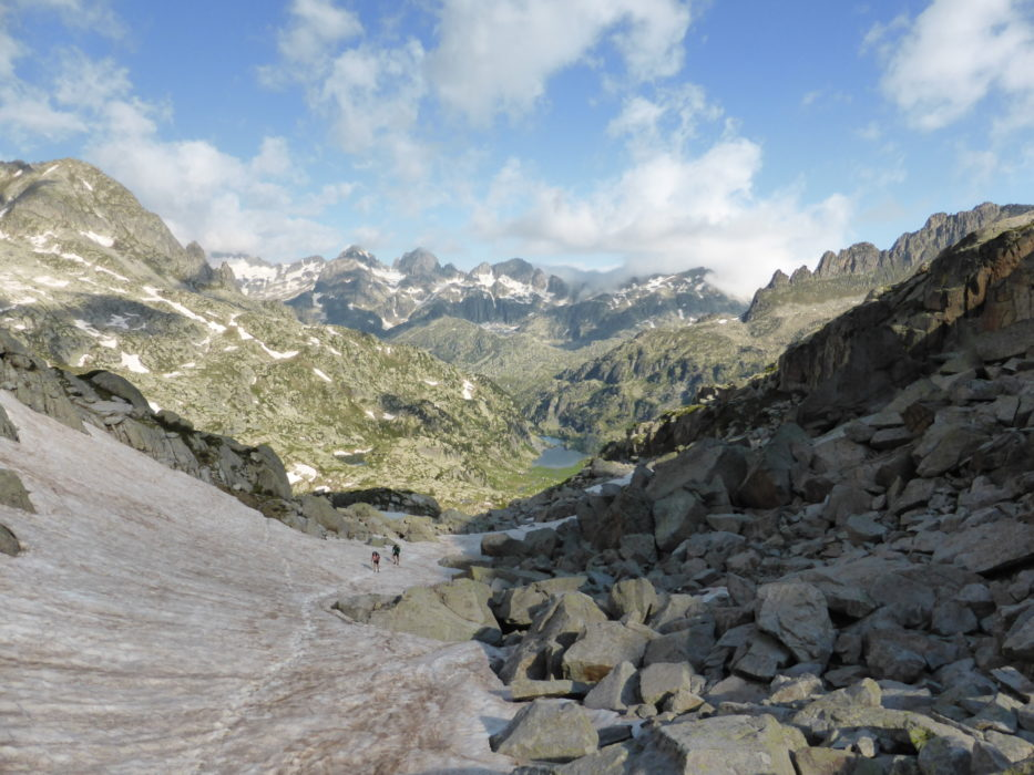 Walkers following the snow track towards the Coll de Contraix