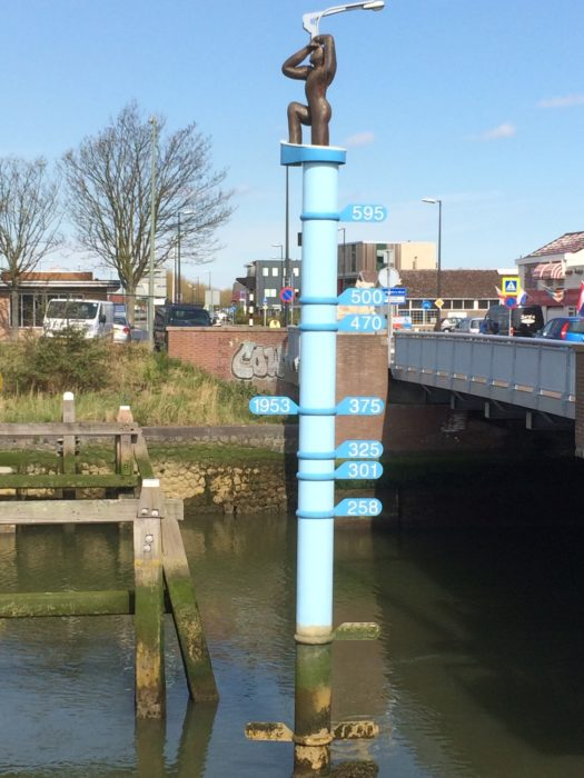 Monument in Maassluis showing the height of water during the floods of 1953