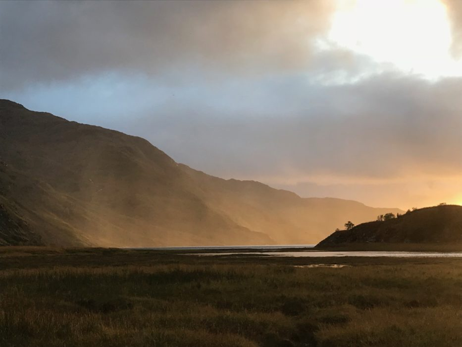 An October sunset lights up a rain shower over Loch Nevis, Knoydart (Photo by Chris Councell)