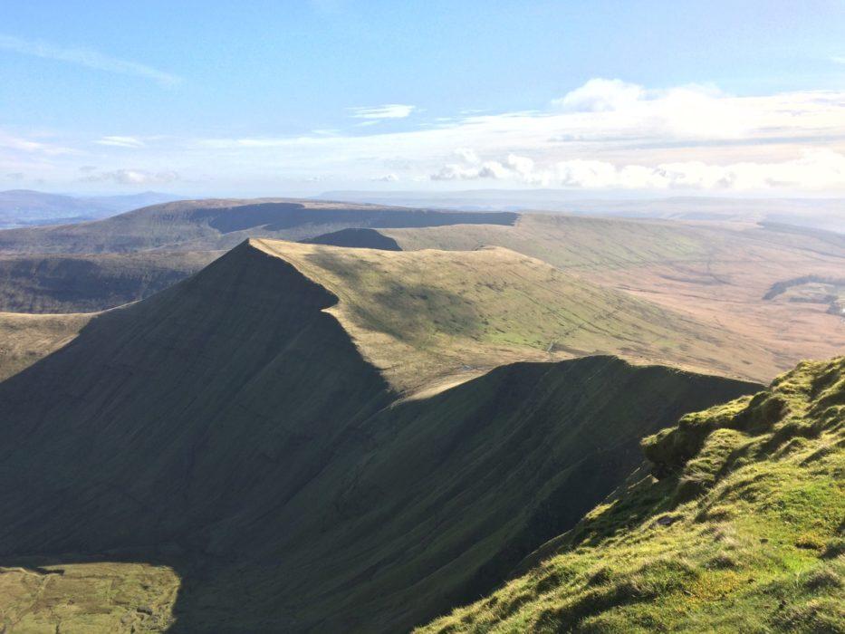 From Pen y Fan the peaks of Cribyn and Fan y Big look like a petrified wave