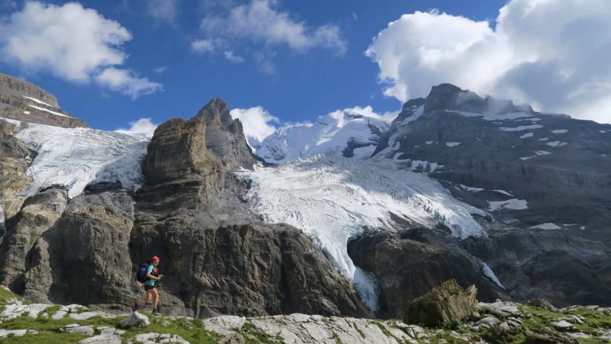 Running along glacial moraine. Alpine Pass Route, Switzerland. (Photo by Chris Councell)