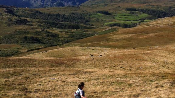 Lily running in the Lakeland fells. Photo by Chris Councell.