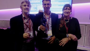 Bashir Daoud, CEO Jordan Trail Association (centre), with Tony and Di after the presentation of the World Tourism Award at this years World Travel Show in London.