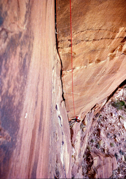 Di Taylor on the first pitch of The Beauty in Tony's guidebook to Treks and Climbs in Wadi Rum.