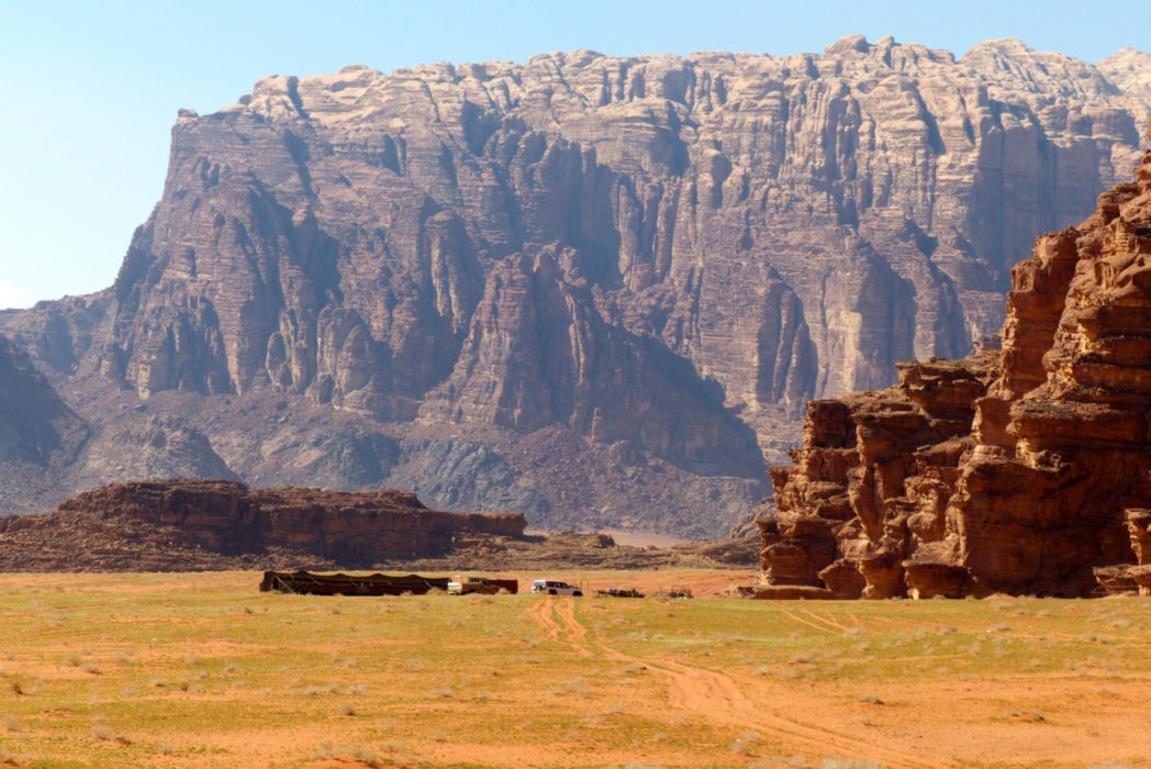 Jebel Rum towers above a Bedouin Camp in Wadi Rum