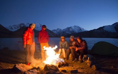 Trekkers enjoying a yak dung fire on the shores of Zarojkul Lake in the Central Pamirs. Even in summer temperatures can drop to freezing levels at altitudes above 4000 metres.