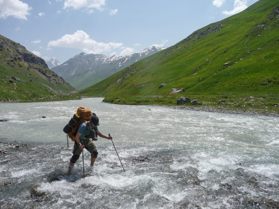 Deeper into the Tajik mountains trekkers can expect multiple river crossings and sometimes have to wait for water levels to drop. Here co-author of the Cicerone guide Trekking in Tajikistan Jan Bakker crosses a tributary of the Yagnob River.