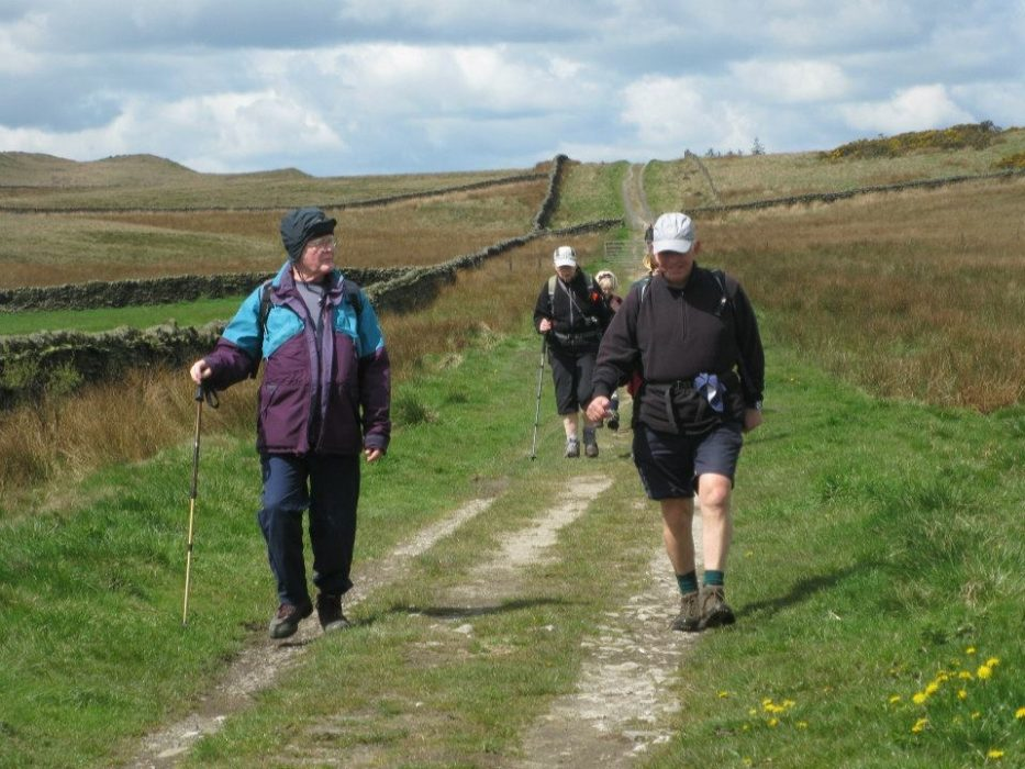 Walkers on the prehistoric track over Skipton Moor