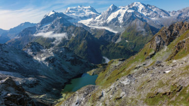 View of the Combin with Cabane de Louvie far below by the lake