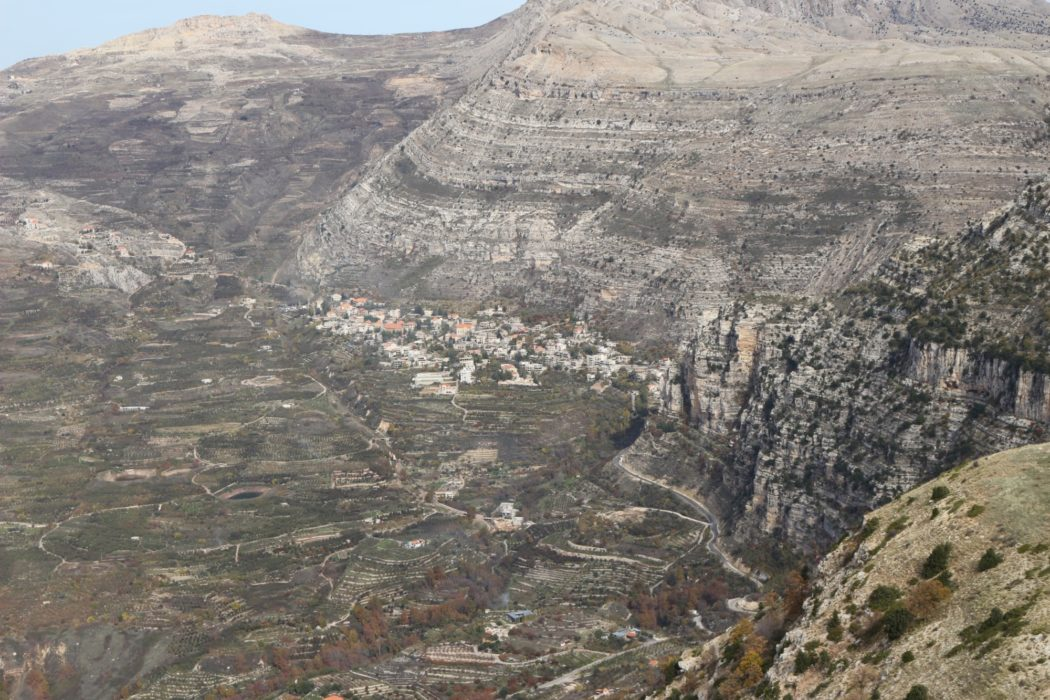 Aaqoura lies tucked up against the escarpment