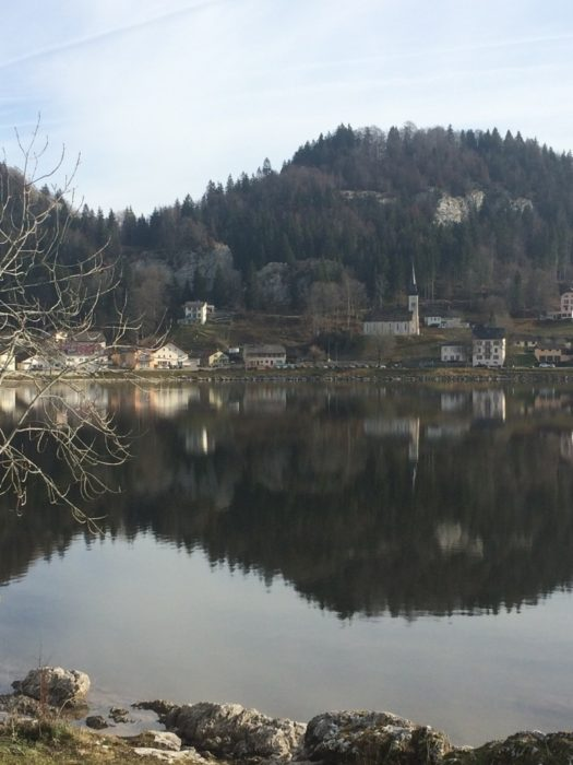 The village of Le Pont, sitting on the shoreline of the highest mountain lake above 1000m in Switzerland, lac du Joux (Stage 11/12)
