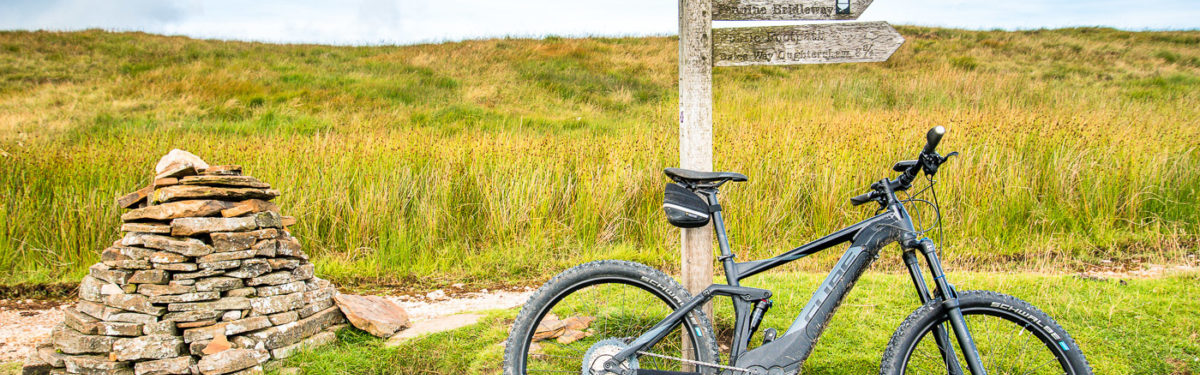 acbbfbb6660 Cube Stereo Hybrid Pro at a cairn on Cam High Road during our Pennine  Bridleway ride