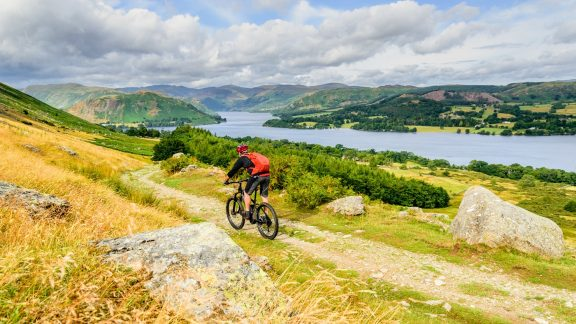 Jon Sparks on the classic Lakeland descent to Howtown, with Ullswater below and Helvellyn on the horizon.