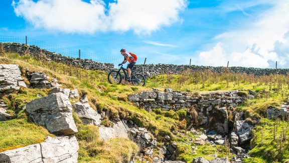 Jon Sparks passes a waterfall on the 'Driving Road' during our Pennine Bridleway ride.