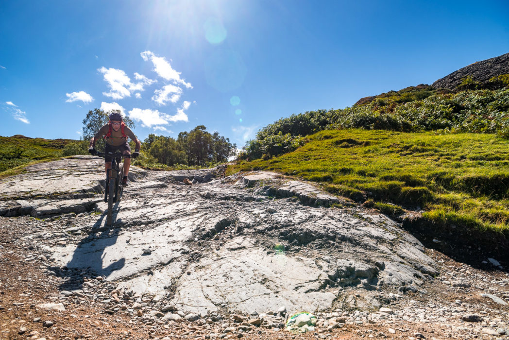 Jon Sparks on exposed bedrock on the descent from Knotts into Little Langdale. The Cube e-bike took all this in its stride.