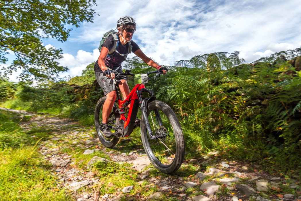 Bernie Carter at speed on the descent of Moor Lane, Grizedale Forest. No e-assist here, just gravity and pure pleasure.