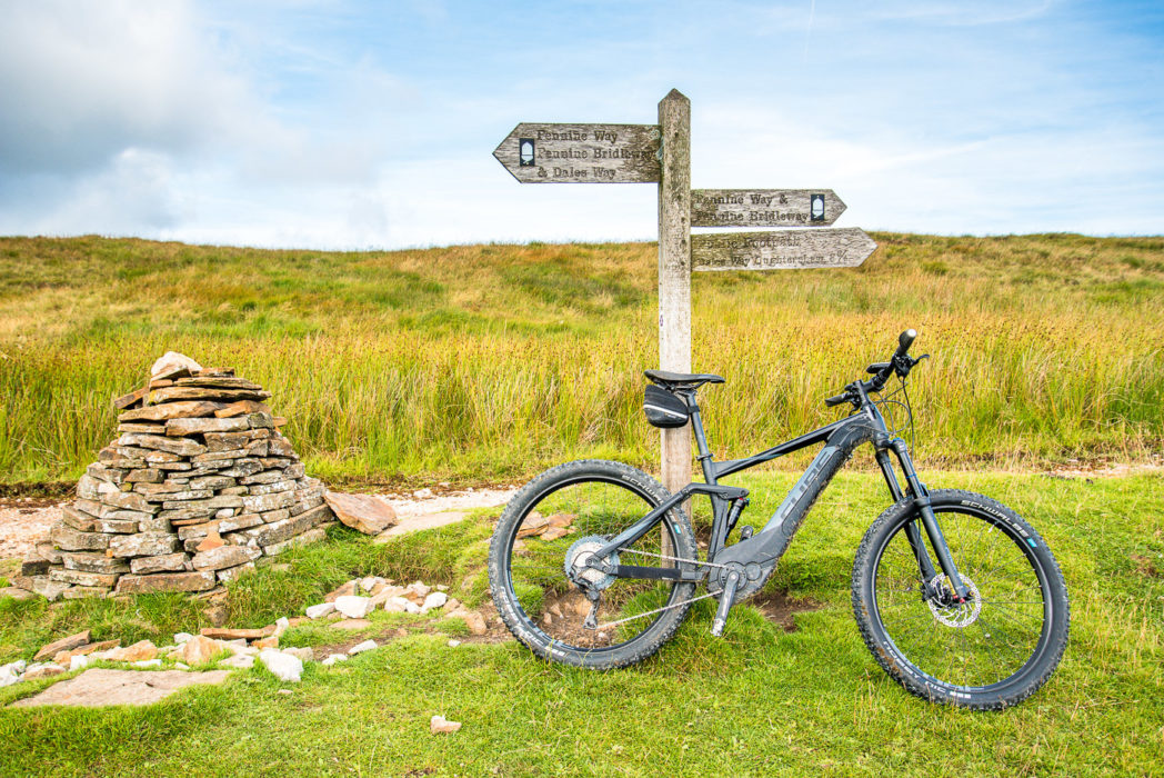 Cube Stereo Hybrid Pro at a cairn on Cam High Road during our Pennine Bridleway ride.