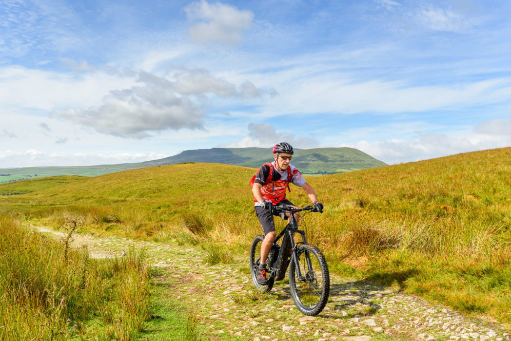 Jon Sparks near the top of Cam High Road, with Ingleborough behind, during our Pennine Bridleway ride. I would have really struggled on this long climb without a bit of e-assist.