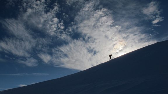 Snowshoeing beneath a stunning skyscape, French Jura