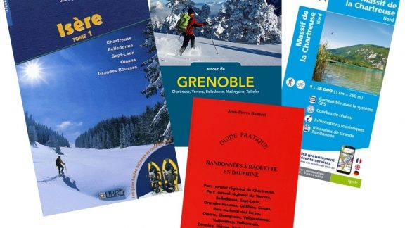 Essential tools for your trip - snowshoe guidebooks and a map