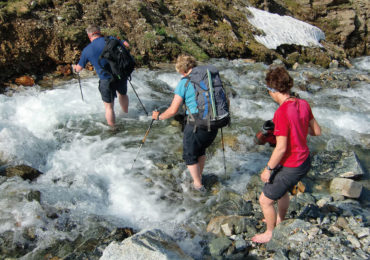 Chilled feet were guaranteed when crossing a stream of snowmelt above Berghaus Vereina  (photo from the Silvretta by Kev Reynolds)