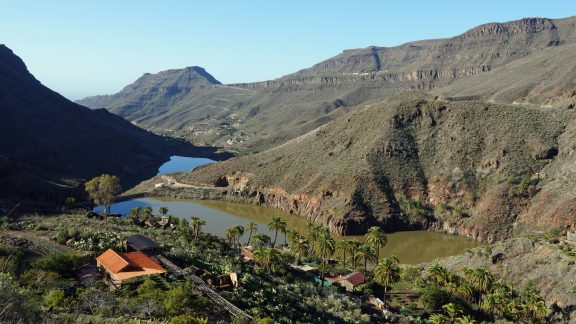 Looking back across two reservoirs to the village of Ayagaures