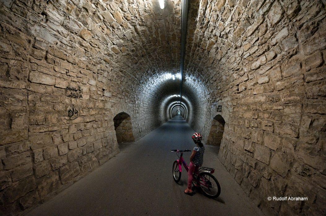 Cycling through the 550m Valeta tunnel near Piran, on the Parenzana cycle route, Slovenia © Rudolf Abraham