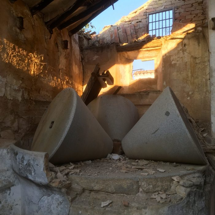 Olive millstones in a crumbling cortijo