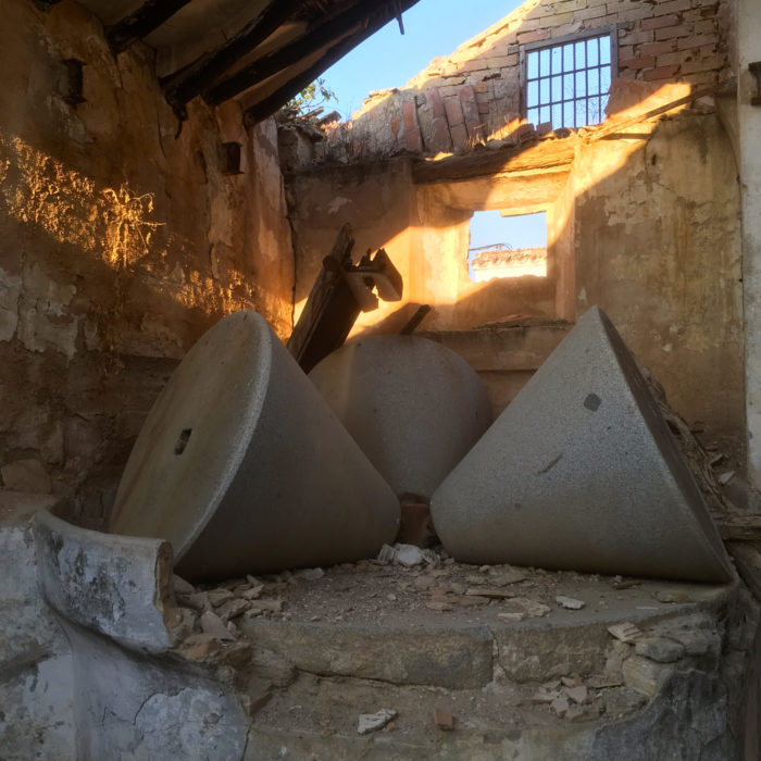 Olive millstones in a crumbling cortijo