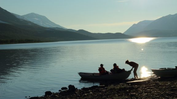 7 Pushing off for an evening crossing of Teusajaure. STF rowing boats are in situ for the entire summer walking season and are equipped with life jackets.