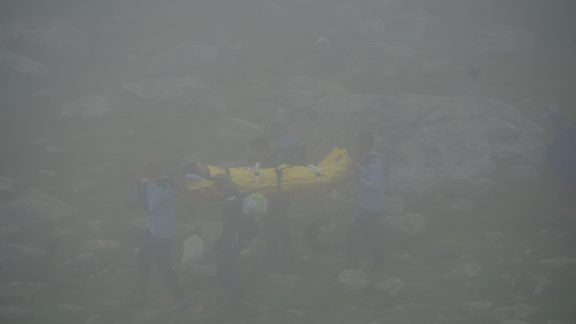 Carrying the unfortunate victim down on a stretcher