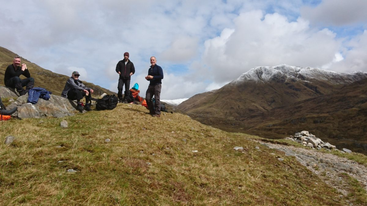 Challengers at the col between Glen Lichd and Glen Affric, with Ciste Dubh beyond