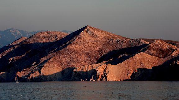 Evening light on the rocky island of Prvić, just off the southern tip of the island of Krk near Baška, Croatia © Rudolf Abraham