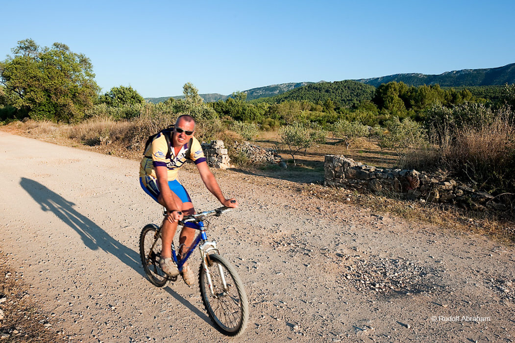 Cycling on Stari Grad Plain, a UNESCO World Heritage Site on the island of Hvar, Croatia © Rudolf Abraham