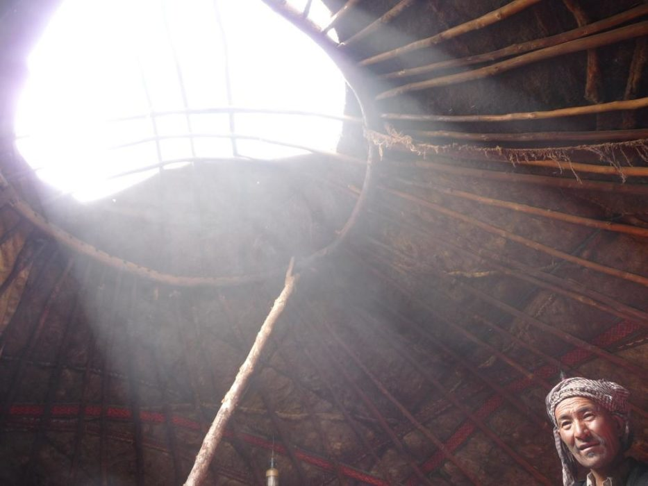 Inside a yurt: sun beams enter a Kyrgyz yurt, Little Pamir