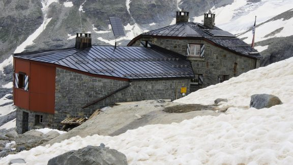 In the early summer, the Coaz Hut is sometimes half-buried by snow