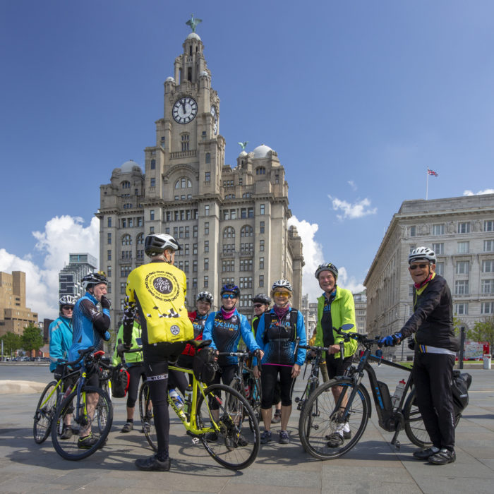 Posing beneath the Liver Building – notice the eclectic collection of bikes