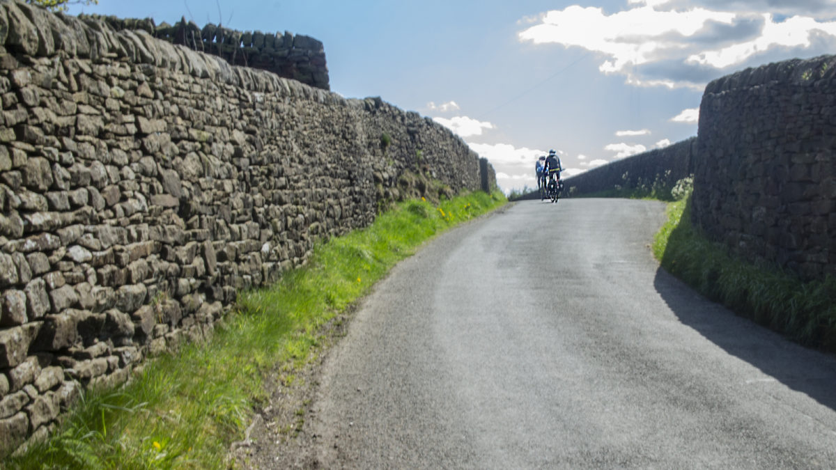 Riding between high stone walls in the Pennines